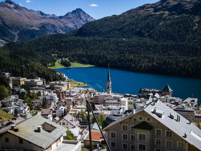 the city of st.moritz watching down on the lake