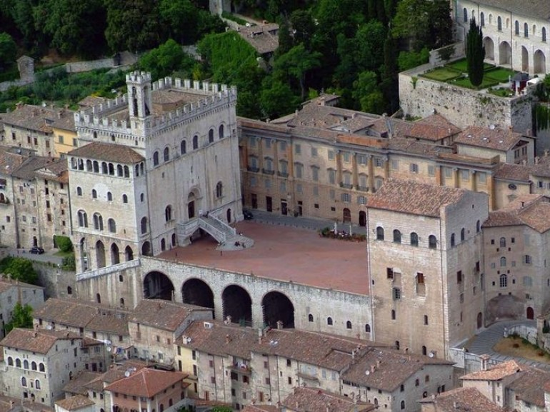 the central square of the city of gubbio and the ancient buildings surrounding it