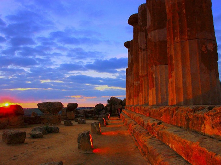 the columns of the temple get red with the sunset
