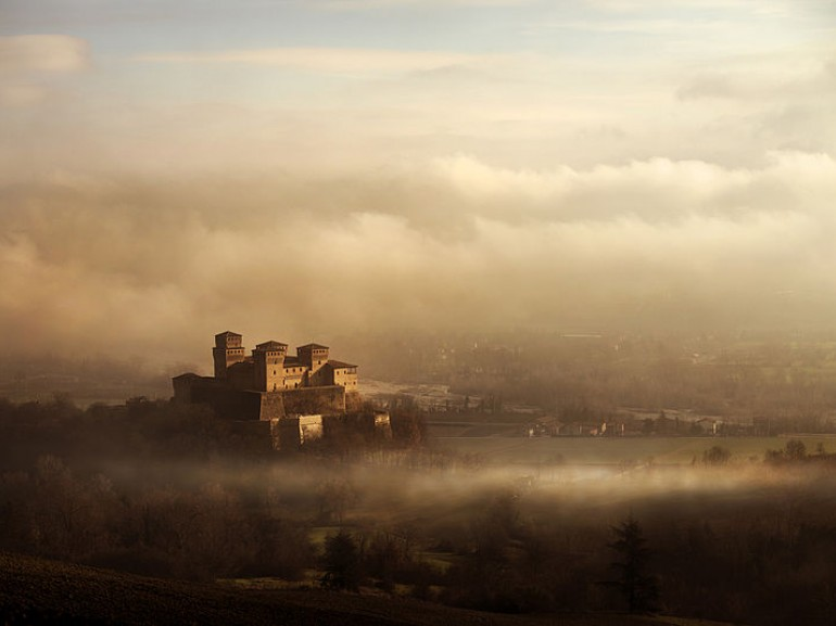 The Torrechiara castle surrounded by fog, Langhirano, Italy