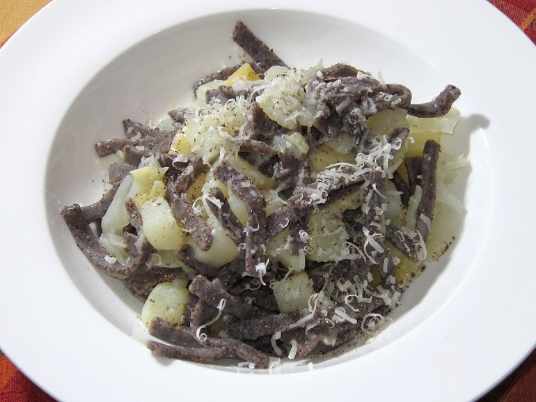 a plate of typical pizzoccheri with cabbage and potatoes