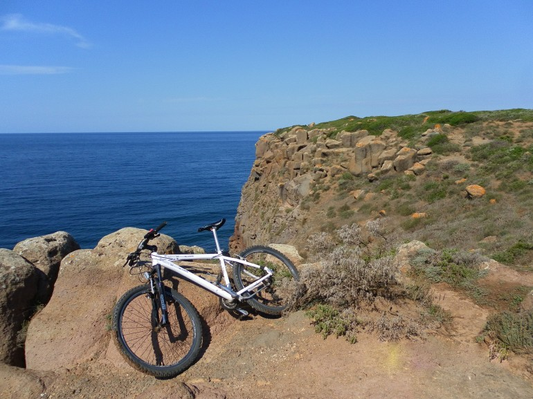 Bicycle on cliff. Discover Fur Denmark by bike