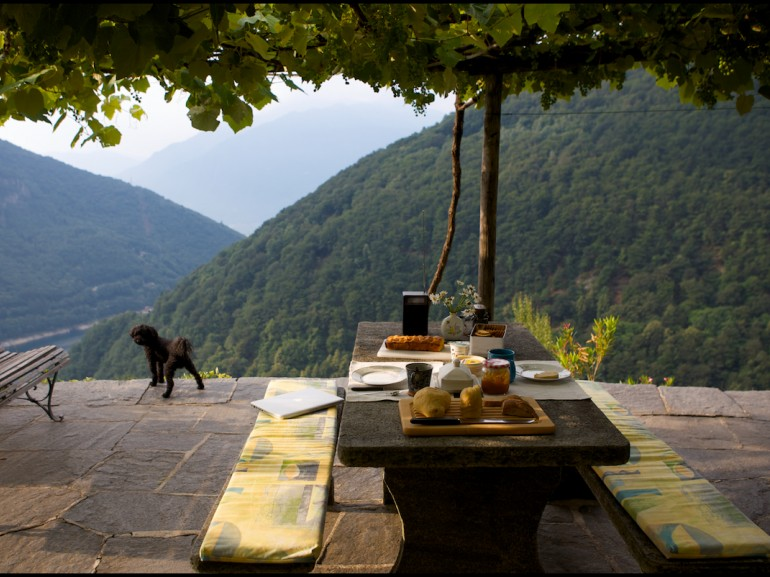 a table ready for breackfast overlooking the lake