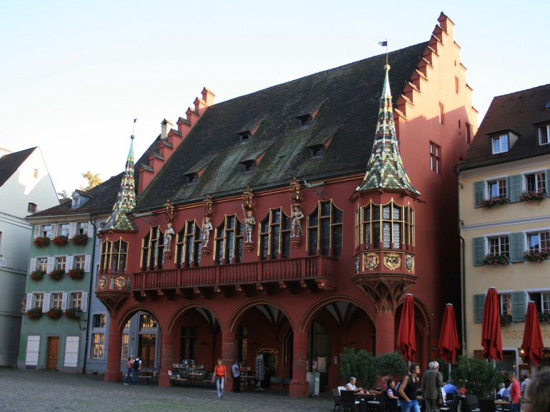 The Kaufhaus, the red building in the main square of Freiburg