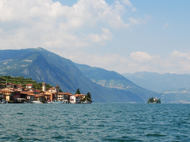 iseo lake with mountains on the background and a city near the coast