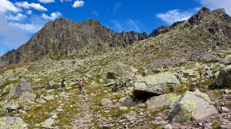 the rocky path towards the top and two people walking on it